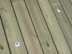 A wood deck that was pressure washed so well it looks brand new again now that it's dry.