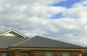 A picture of a domestic home with  a roof cleaned by professionals